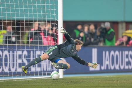qualifier: VIENNA,  AUSTRIA - MARCH 22 Gunnar Nielsen (#1 Faroe Islands) cannot stop the ball during the world cup qualifier game on March 22, 2013 in Vienna, Austria.