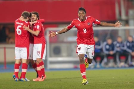qualifier: VIENNA,  AUSTRIA - MARCH 22 David Alaba (#8 Austria) celebrates a goal during the world cup qualifier game on March 22, 2013 in Vienna, Austria.