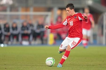 qualifier: VIENNA,  AUSTRIA - MARCH 22 Zlatko Junuzovic (#10 Austria) kicks the ball during the world cup qualifier game on March 22, 2013 in Vienna, Austria. Editorial