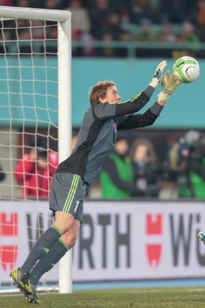 qualifier: VIENNA,  AUSTRIA - MARCH 22 Gunnar Nielsen (#1 Faroe Islands) catches the ball during the world cup qualifier game on March 22, 2013 in Vienna, Austria.