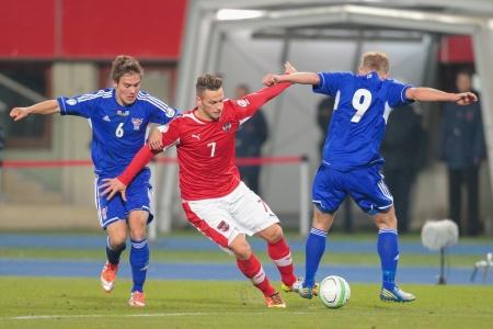 qualifier: VIENNA,  AUSTRIA - MARCH 22 Marko Arnautovic (#7 Austria) and Hallur Hansson (#6 Faroe Islands) fight for the ball during the world cup qualifier game on March 22, 2013 in Vienna, Austria.