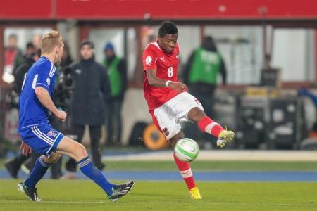 qualifier: VIENNA,  AUSTRIA - MARCH 22 David Alaba (#8 Austria) kicks the ball during the world cup qualifier game on March 22, 2013 in Vienna, Austria.