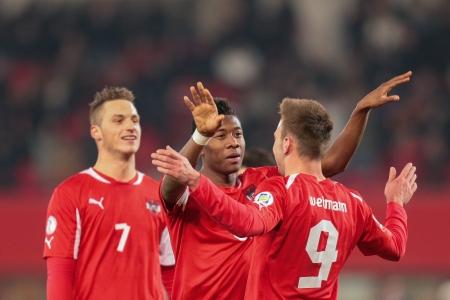 VIENNA,  AUSTRIA - MARCH 22 Andreas Weimann (#9 Austria) and David Alaba (#8 Austria) celebrate a goal during the world cup qualifier game on March 22, 2013 in Vienna, Austria.