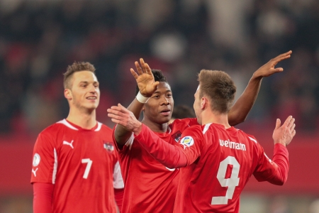 qualifier: VIENNA,  AUSTRIA - MARCH 22 Andreas Weimann (#9 Austria) and David Alaba (#8 Austria) celebrate a goal during the world cup qualifier game on March 22, 2013 in Vienna, Austria.