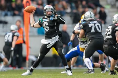 kyle: INNSBRUCK,  AUSTRIA - MARCH 23 QB Kyle Callahan (#6 Raiders) throws the ball during the AFL football game on March 23, 2013 in Innsbruck, Austria.
