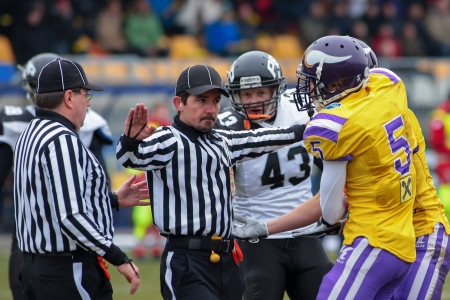 VIENNA,  AUSTRIA - MARCH 24 WR Laurinho Walch (#5 Vikings) has discussion with referee Bojan Savicevic during the AFL football game on March 24, 2013 in Vienna, Austria.