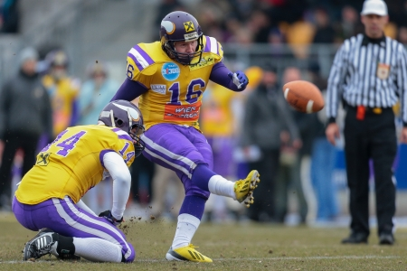 afl: VIENNA,  AUSTRIA - MARCH 24 P Christopher Kappel (#16 Vikings) kicks the ball during the AFL football game on March 24, 2013 in Vienna, Austria.