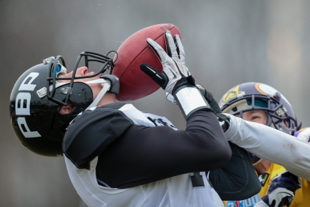 afl: VIENNA,  AUSTRIA - MARCH 24 WR Dan Balažovič (#17 Panthers) catches the ball during the AFL football game on March 24, 2013 in Vienna, Austria.