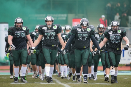 afl: VIENNA,  AUSTRIA - APRIL 6 The team of the Danube Dragons enter the stadium before the AFL football game on April 6, 2013 in Vienna, Austria.