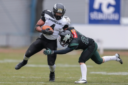 afl: VIENNA,  AUSTRIA - APRIL 6 DB Mario Vetr (#23 Dragons) tackles DB Andre Whyte (#4 Panthers) during the AFL football game on April 6, 2013 in Vienna, Austria.