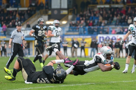 afl: WIENER NEUDORF,  AUSTRIA - APRIL 20 RB Jaycen Taylor Spears (#7 Raiders) scores a touchdown during the AFL football game on April 20, 2013 in Wiener Neudorf, Austria. Editorial