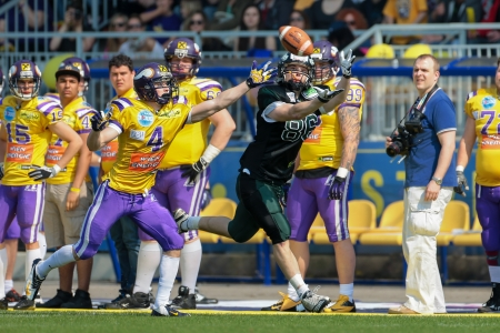 afl: VIENNA,  AUSTRIA - APRIL 21 WR Georg Pongratz (#86 Dragons) catches the ball during the AFL football game on April 21, 2013 in Vienna, Austria.