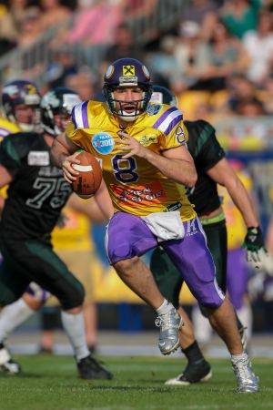 afl: VIENNA,  AUSTRIA - APRIL 21 QB Christoph Gross (#8 Vikings) runs with the ball during the AFL football game on April 21, 2013 in Vienna, Austria. Editorial