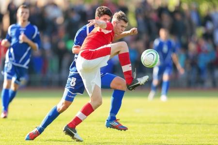 TRAISKIRCHEN, AUSTRIA - JUNE 5 Lukas Jäger (#3 Austria) and Mirko Marić (#8 Bosnia and Herzegovina) fight for the ball during the U19 game on June 5, 2013 in Traiskirchen, Austria.