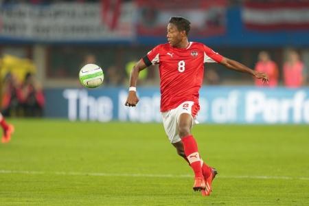 qualifier: VIENNA,  AUSTRIA - JUNE  7 David Alaba (#8 Austria) kicks the ball during the world cup qualifier game on June 7, 2013 in Vienna, Austria.