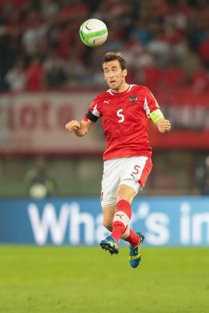 qualifier: VIENNA,  AUSTRIA - JUNE  7  Christian Fuchs (#5 Austria) heads the ball during the world cup qualifier game on June 7, 2013 in Vienna, Austria.