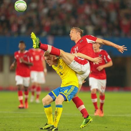 qualifier: VIENNA,  AUSTRIA - JUNE  7 Marc Janko (#21 Austria) and Rasmus Elm (#6 Sweden) fight for the ball during the world cup qualifier game on June 7, 2013 in Vienna, Austria. Editorial