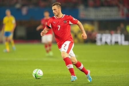 qualifier: VIENNA,  AUSTRIA - JUNE  7 Marko Arnautovic (#7 Austria) runs with the ball during the world cup qualifier game on June 7, 2013 in Vienna, Austria.