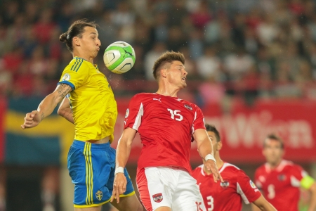 VIENNA,  AUSTRIA - JUNE  7 Sebastian Prödl (#15 Austria) and Zlatan Ibrahimovic (#10 Sweden) fight for the ball during the world cup qualifier game on June 7, 2013 in Vienna, Austria.