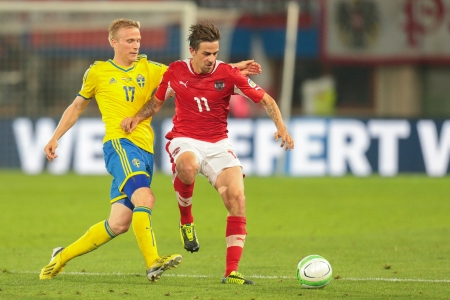 qualifier: VIENNA,  AUSTRIA - JUNE  7 Martin Harnik (#11 Austria) and Oscar Wendt (#17 Sweden) fight for the ball during the world cup qualifier game on June 7, 2013 in Vienna, Austria.