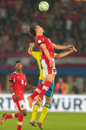 qualifier: VIENNA,  AUSTRIA - JUNE  7 Alexander Kacaniklic (#19 Sweden) and Julian Baumgartlinger (#14 Austria) fight for the ball during the world cup qualifier game on June 7, 2013 in Vienna, Austria. Editorial