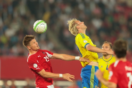 camaraderie: VIENNA,  AUSTRIA - JUNE  7 Ola Toivonen (#20 Sweden) and Sebastian Prödl (#15 Austria) fight for the ball during the world cup qualifier game on June 7, 2013 in Vienna, Austria.