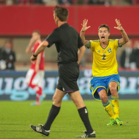 qualifier: VIENNA,  AUSTRIA - JUNE  7 Mikael Lustig (#2 Sweden), complains to Referee Gianluca Rocchi (Italy) during the world cup qualifier game on June 7, 2013 in Vienna, Austria. Editorial