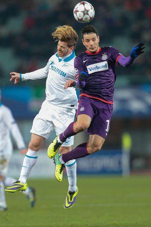 cristian: VIENNA, AUSTRIA - DEZEMBER 11 Cristian Ansaldi (#3 Zenit) and Philipp Hosiner (#16 Austria) fight for the ball at a UEFA Champions League game on Dezember 11, 2013 in Vienna, Austria.