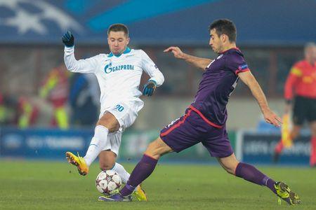 qualifier: VIENNA, AUSTRIA - DEZEMBER 11 Kaja Rogulj (#4 Austria) and Viktor Fayzulin (#20 Zenit) fight for the ball at a UEFA Champions League game on Dezember 11, 2013 in Vienna, Austria. Editorial