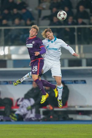cristian: VIENNA, AUSTRIA - DEZEMBER 11 Cristian Ansaldi (#3 Zenit) and Daniel Royer (#28 Austria) fight for the ball at a UEFA Champions League game on Dezember 11, 2013 in Vienna, Austria.