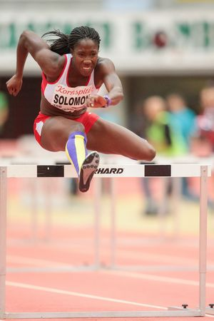 LINZ, AUSTRIA - JANUARY 30, 2014: Serita Solomon (#356 Great Britain) places 3rd in the womens 60m hurdles event in an indoor track and field meeting.