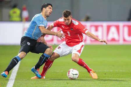 KLAGENFURT, AUSTRIA - MARCH 05, 2014: Aleksandar Dragovic (#3 Austria) and Luis Suarez (#9 Uruguay) fight for the ball in a friendly soccer game between Austria and Uruguay. Editorial