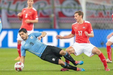 9 ball: KLAGENFURT, AUSTRIA - MARCH 05, 2014: Florian Klein (#17 Austria) and Luis Suarez (#9 Uruguay) fight for the ball in a friendly soccer game between Austria and Uruguay.