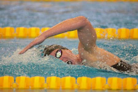 medley: GRAZ, AUSTRIA - APRIL 04, 2014:  Joerdis Steinegger (Austria) wins the womens 4x100m medley event in an indoor swimming meeting.