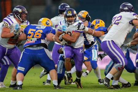 afl: GRAZ, AUSTRIA - JUNE 29 RB Jesse Lewis (#28 Vikings) runs with the ball at the playoffs of the AFL on June 29, 2013 in Graz, Austria.
