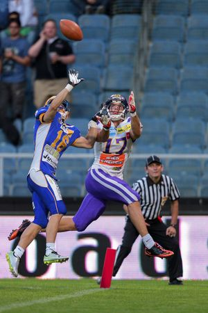 afl: GRAZ, AUSTRIA - JUNE 29 DB Stefan Lechner (#16 Giants) and WR Stefan Holzinger (#17 Vikings) fight for the ball at the playoffs of the AFL on June 29, 2013 in Graz, Austria. Editorial