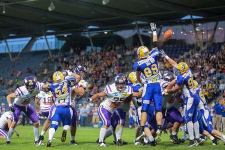 playoffs: GRAZ, AUSTRIA - JUNE 29 K Sabastian Daum (#18 Vikings) kicks a PAT at the playoffs of the AFL on June 29, 2013 in Graz, Austria.