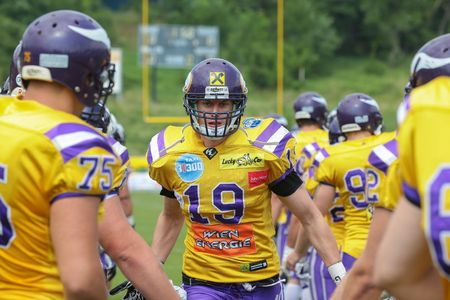 afl: VIENNA, AUSTRIA - JULY 14 WR Christoph Budimir (#19 Vikings) is greeted by his teammates before the playoff game of the AFL on July 14, 2013 in Vienna, Austria. Editorial