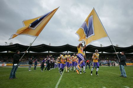 afl: VIENNA, AUSTRIA - MARCH 23, 2014: The team of the Raiffeisen Vikings runs on the field before an AFL football game.