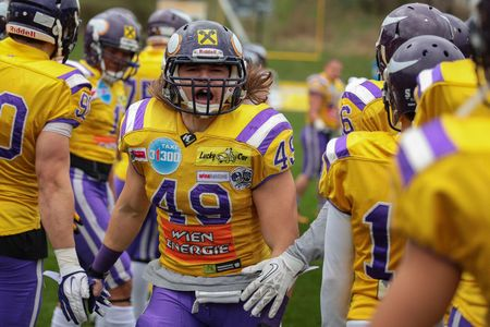 afl: VIENNA, AUSTRIA - MARCH 23, 2014: LB Simon Blach (#49 Vikings) is welcomed by his teammates before an AFL football game.