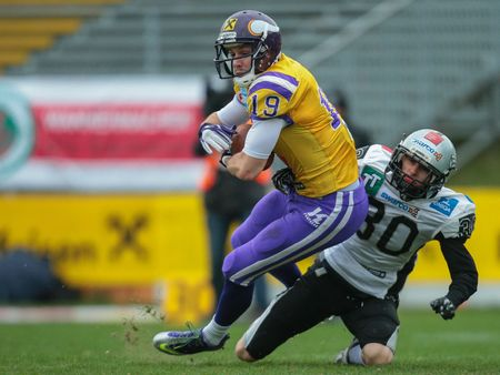 afl: VIENNA, AUSTRIA - MARCH 23, 2014: WR Stefan Postel (#19 Vikings) catches the ball in an AFL football game.