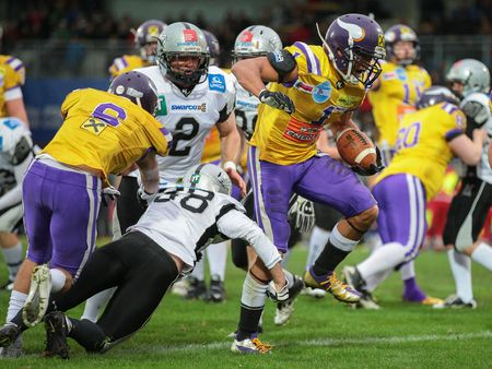 afl: VIENNA, AUSTRIA - MARCH 23, 2014: RB Emmanuel Pan-Sok Moody (#1 Vikings) runs with the ball in an AFL football game.