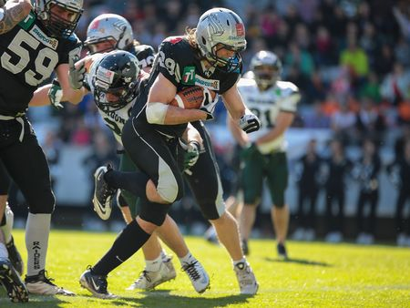 INNSBRUCK, AUSTRIA - MARCH 29, 2014: RB Andreas Hofbauer (#29 Raiders) runs with the ball in an AFL football game.
