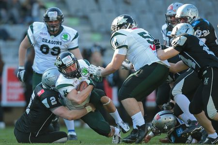 afl: INNSBRUCK, AUSTRIA - MARCH 29, 2014: RB Dominik Kecskemeti (#1 Dragons) runs with the ball in an AFL football game.