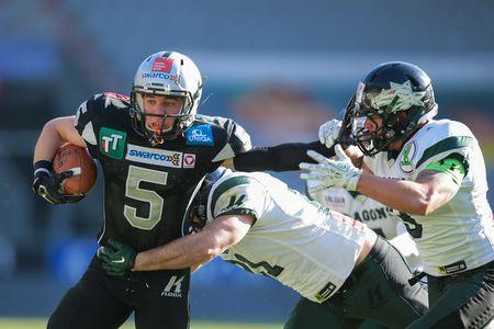 INNSBRUCK, AUSTRIA - MARCH 29, 2014: WR Adrian Platzgummer (#5 Raiders) runs with the ball in an AFL football game. Editorial