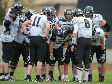 kyle: GRAZ, AUSTRIA - APRIL 04, 2014: QB Kyle Newhall (#8 Panthers) talks to his teammates in an AFL football game. Editorial