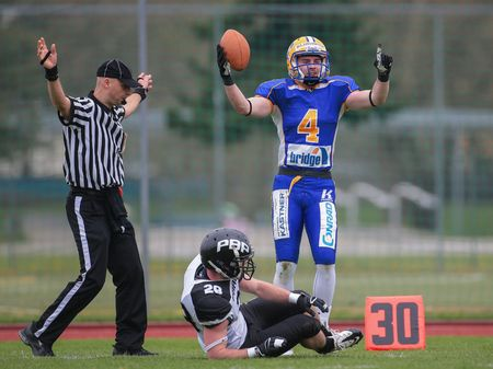 afl: GRAZ, AUSTRIA - APRIL 04, 2014: WR Philipp Sommer (#4 Giants) catches the ball in an AFL football game.