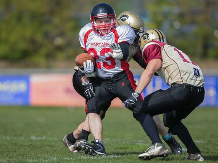 legionaries: WINDEN, AUSTRIA - APRIL 12, 2014: RB Thomas Weis (#23 Spartans) runs with the ball. Editorial