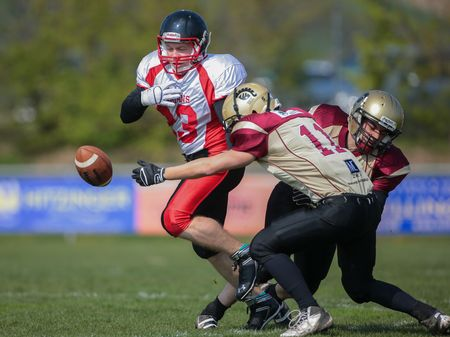 legionaries: WINDEN, AUSTRIA - APRIL 12, 2014: RB Thomas Weis (#23 Spartans) loses the ball