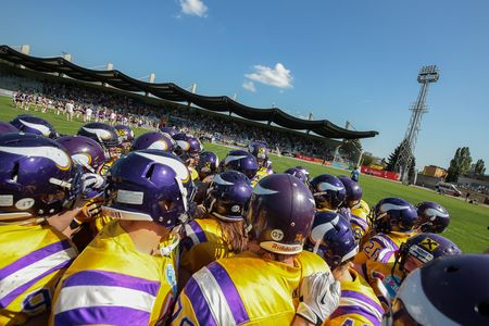 touchdown: VIENNA, AUSTRIA - APRIL 27, 2014: The team of the Vienna Vikings in the huddle before the game.